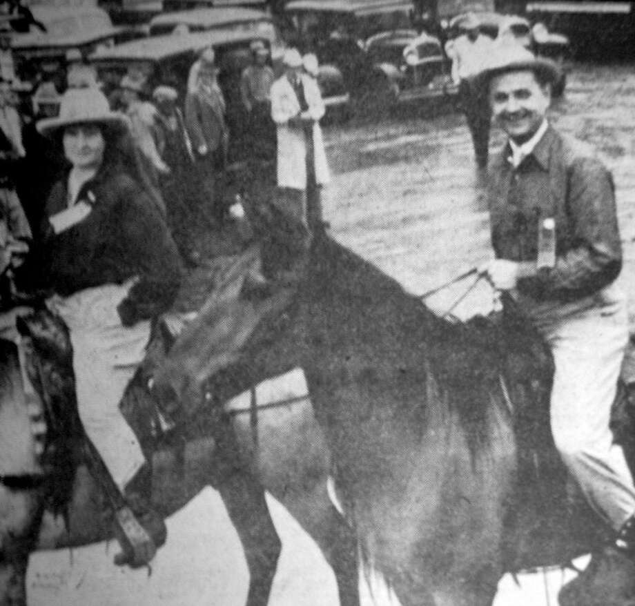 Herald File PhotoTexas Gov. James V. Allred, accompanied by Business and Professional Women's Club official Mrs. Ed Hart, rides in the 1936 Pioneer Roundup Parade in Plainview astride a cowpony provided by Knox Crews. Allred was in Plainview to celebrate the community's 50th anniversary as well as the Texas centennial.