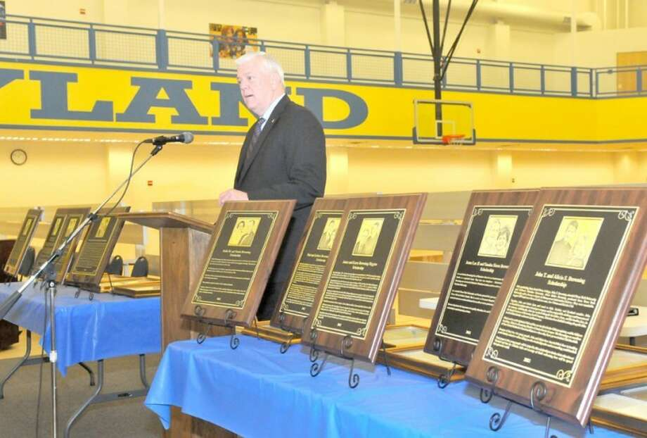 Richard Porter/Wayland Baptist UniversityDr. Paul Armes addresses a crowd at the 2012 Homecoming Luncheon, surrounded by a number of plaques recognizing individuals for whom scholarships have been endowed and established.