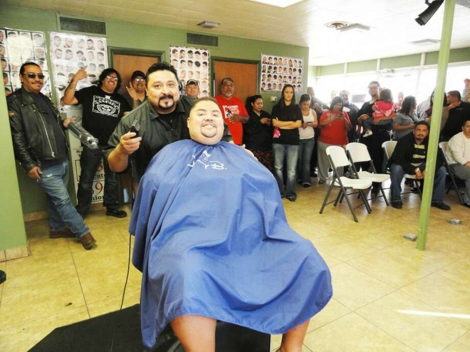 Comedian Gabriel Iglesias received a haircut from friend Mike Ferrer on Friday morning, and by the time he was finished, a large crowd had formed in the downtown La Barber Shop. The nationally-known comedian, aka Fluffy, performed his act in Lubbock on Thursday night and in Amarillo on Friday.
