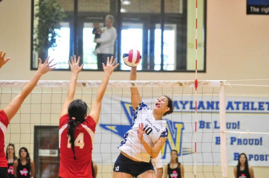 Wayland Baptist senior Tatiana Gonzalez (10) gets a kill as Mid-America Christian's Calle Solie defends during a Sooner Athletic Conference match on Saturday in Hutcherson Center. Photo: Ryan Thurman/Plainview Herald