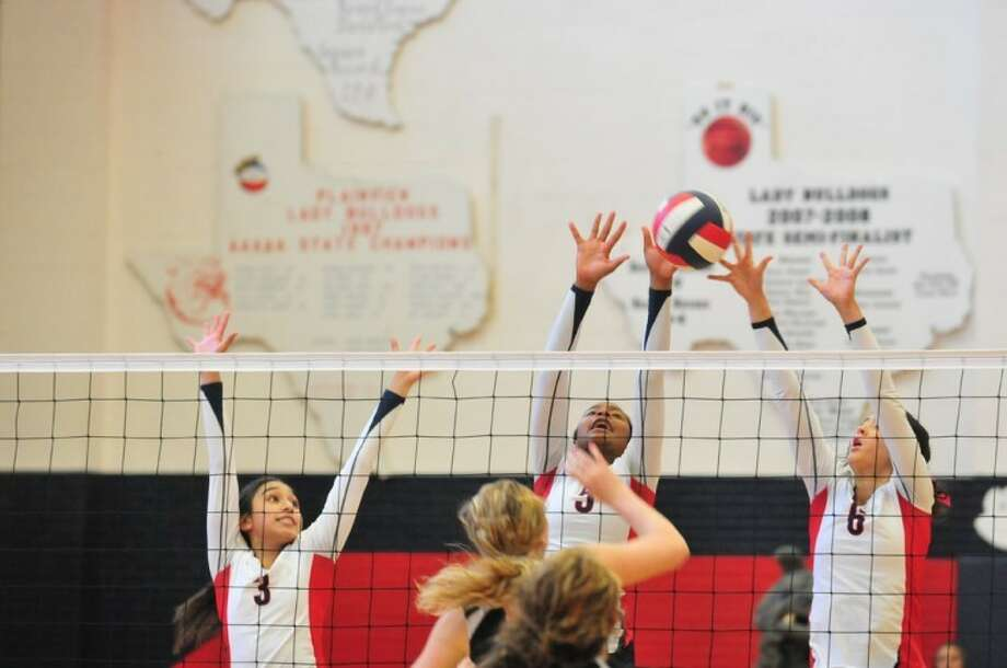 The Plainview Lady Bulldogs' Lupita Quintanilla (3), Taivia Hearn (5) and Shalee Bennett try to block Dumas' Allison Kiewiet's attack during a District 3-4A match Saturday in the DogHouse. The Lady Dogs wrap up their season at 7 tonight against the Frenship Lady Tigers in Wolfforth. Also today, the Plainview Christian Lady Eagles take on Bellville Faith in Bellville at 6 p.m. while Wayland goes against UT-Permian Basin in Odessa at 7.