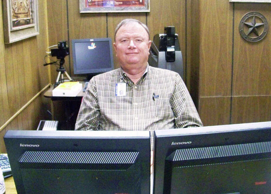 Capt. Mike Allen of the Plainview Police Department sits in his nearly empty office as his official last day with the city is today.