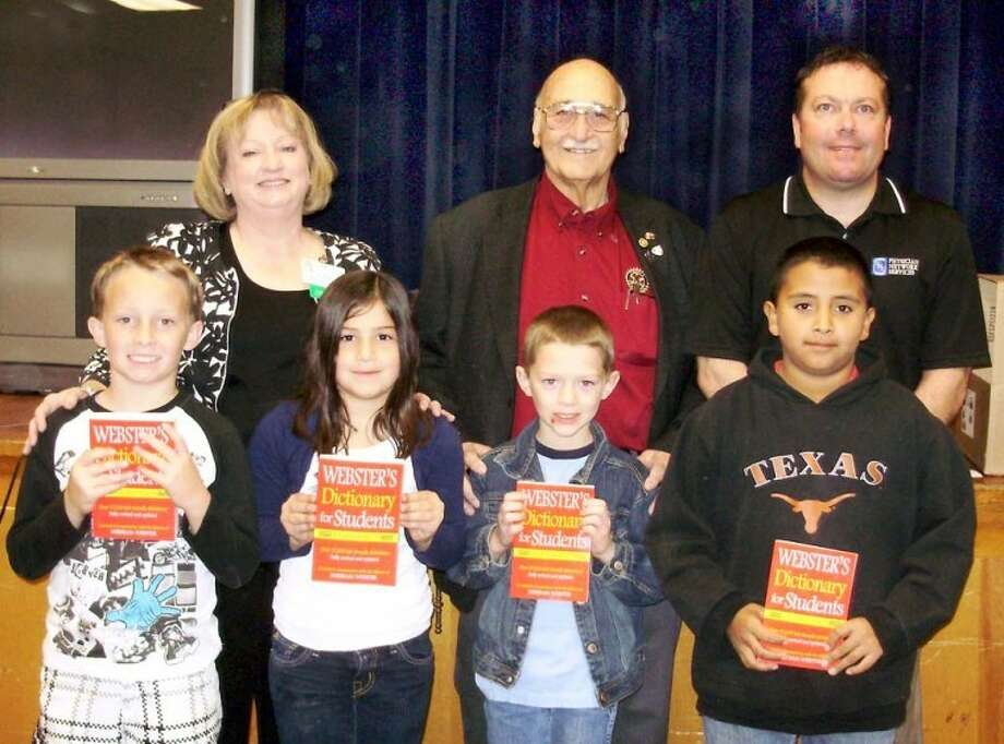 Donna Isaacson/College HillAs part of their annual initiative to donate dictionaries to area third-grade students to encourage frequent dictionary use, Plainview Rotary Club donated dictionaries to College Hill students Ryan Hancock (front, left), Morgan Hastey, Colton Derrick and Baldo Garcia. Rotarians pictured are Coralyn Dillard, Max Browning and Anthony Brocato.