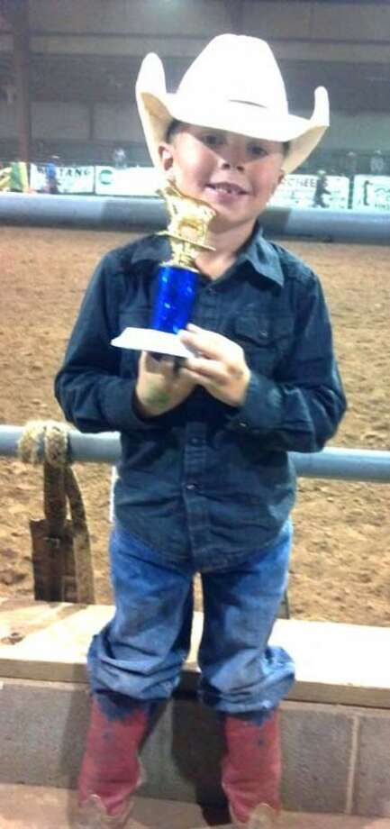Kail Brunson, 5, won the weekly mutton busting (sheep riding) championship at Charlie Thompson's Rodeo in Lubbock on Saturday night. Kail is the son of John and Katie Brunson of Plainview and the grandson of Ron and Marianne Brunson of Plainview and Tim and Randa Massey of Hale Center. He is the great-grandson of Bobby and Edna Wardlaw of Hale Center and Gladys Munz of Clovis, N.M. Photo: Courtesy Photo