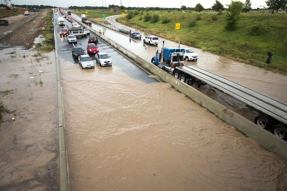 High water slows U.S. 59 in both directions at FM 762. Only large trucks making it through. Road closed to other vehicles on Tuesday, July 26, 2016, in Richmond.