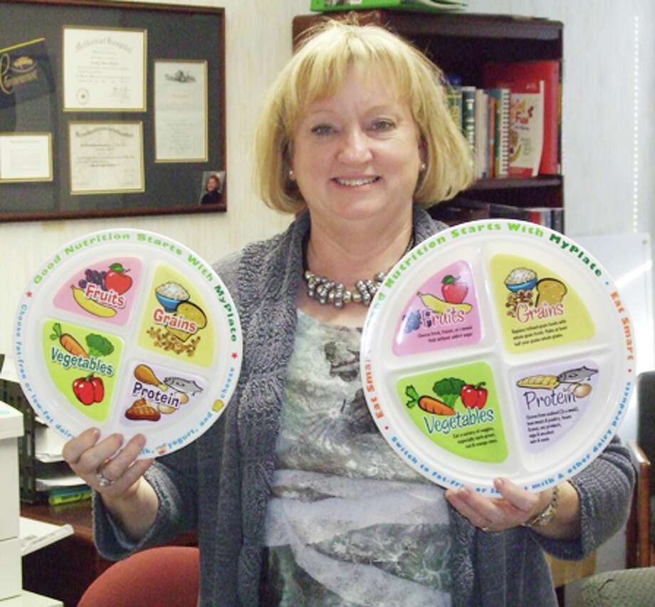 Diabetes educator Coralyn Dillard of Covenant Plainview holds up audiovisual aids that help people understand what a balanced meal looks like. November is National Diabetes Month. Photo: Gail M. Williams | Plainview Herald