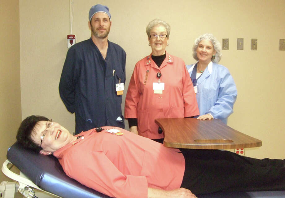 Having some fun while looking around Covenant Hospital Plainview's future outpatient surgery site are Jeremy Foster, R.N. (left); Rose Ann Bailey, Covenant Hospital Auxiliary president-elect; Lauren Hall, R.N;. and auxiliary President Janice Posey on the gurney. Money raised from last year's Christmas greeting fundraiser was used to convert this area, formerly an ICU but lately used for storage, to a much-needed space for outpatients. The hospital performs, on average, 60 outpatient procedures per week. Photo: Shanna Sissom/Plainview Herald