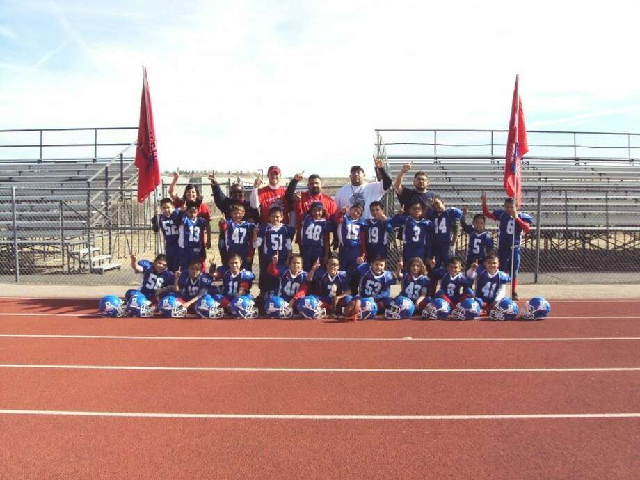 Plainview's Pop Warner Mighty Mites Bulldog football team celebrates their win at the Pikes' Peak Showdown in Colorado. The Mites consists of: Tanner Timms, Zachary Hernandez, Diego Hernandez, Braxlyn Mora, Mathew Zapata, Maliki Hinojosa, Patrick Isaguirre, Myles Sanchez, Marco Godino, Thomas Sanchez, Marc Sepeda, Adrian Salazar, Ethan Daughrity, Christopher Alvarez, Daniel Pineda, Alton Washington, Gavin Galvan, Tyrese Shivers, Talon Ballesteros, Zaven Ponder, Dominick Vargas, Jeremiah Rosas, Devyn Gajdos, Victor A. Vaquera. Coaches are Richard Mora, Keven Gajdos, Adrian Hernandez, Joe P. Isaquirre, John David Lockridge and Frank Perez Photo: Courtesy Photo
