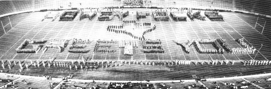 "Members of the Plainview High School Band join with other bands to form ""Howdy Folks, Texas Greets You"" at the Cotton Bowl in Dallas in 1949. The PHS band was one of 20 Texas bands invited to participate in ""Music Day"" at the Texas State Fair that October. Photo: Pictorial History Of Hale County, Texas"