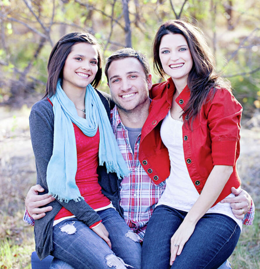 Pastor Justen Quebe with adopted daughter Erica (left) and wife Crystal. Photo: Gail M. Williams/Plainview Herald