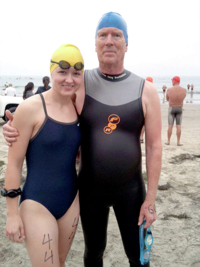 Charles Tanner of Plainview and his daughter-in-law, Caitlyn, of Rio Rancho, N.M., prior to swimming five miles in the Pacific Ocean as part of the Tour of Buoys. Photo: Courtesy Photo
