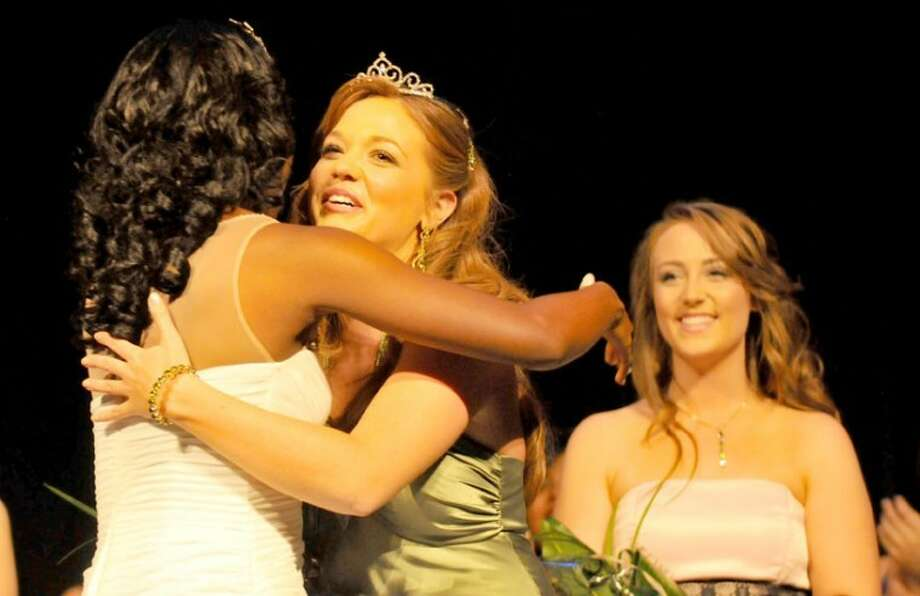 Miss Wayland 2013 Amanda Page (center) is congratulated by Miss Wayland 2012 Dananai Semwayo during Saturday's Miss Wayland Scholarship Pageant at Harral Auditorium as first runner-up Jenna Swift looks on. Page is a senior English major from Plano who represented the School of Language and Literature. She was one of 16 women vying for the crown. Photo: Richard Porter | Wayland Baptist University