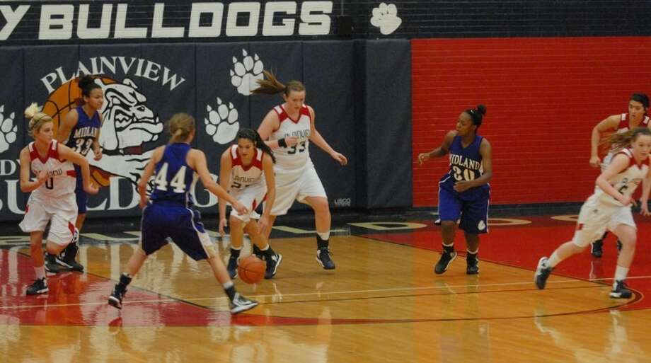 Lady Dogs Karli Wheeler and Bailey Davis make a dash during Tuesday's game. Photo: Homer Marquez/Plainview Herald