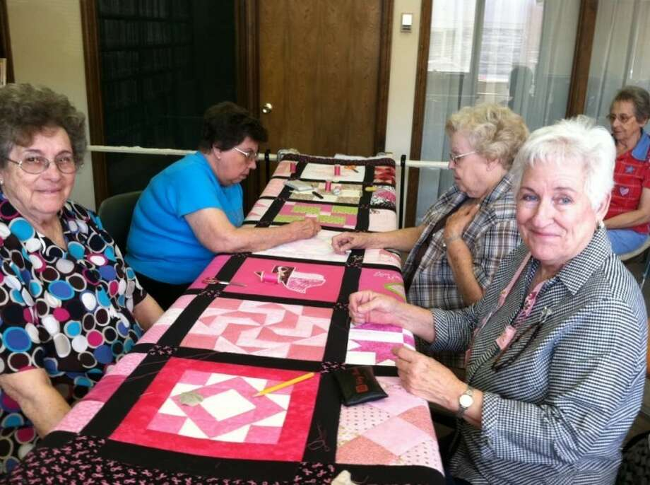 Courtesy PhotoCindy Bertrand took this photo of her mother, Carolyn Marble (right, front) when they quilted with the Silver Thimbles Quilting Club in Lockney on the day they finished the Friend to Friend Pink Event Quilt. Tickets for the quilt are $5 or three for $10 and are available by calling the Floyd County Texas AgriLife Extension office at 983-4912. Deadline is Dec. 31. Also pictured are Geneva Barclay (left), Annabel Bramlet, Wanda Smith and Johnnie Quisenberry.