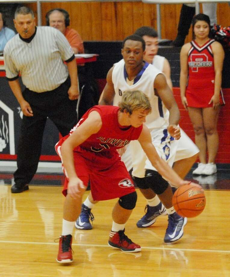 Bulldog Karson Hembree makes the steal during Plainview's Tuesday night game against the 5-A Midland Bulldogs.
