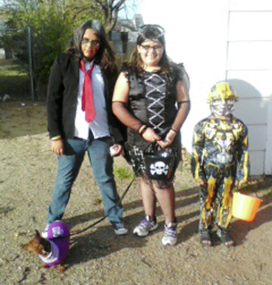 Fifteen-year-old Cynthia Sanchez, dressed as a zombie, (left), MaryBeth Sanchez, a dark angel, 12, and Jiro Sanchez,7, BumbleBee from Transformers, paused for a picture before heading to trunk-or-treat at Garland Street Church of Christ.  (Send your Halloween photos to jthornton@hearstnp.com to be posted at MyPlainview.com.) Photo: Courtesy Photo