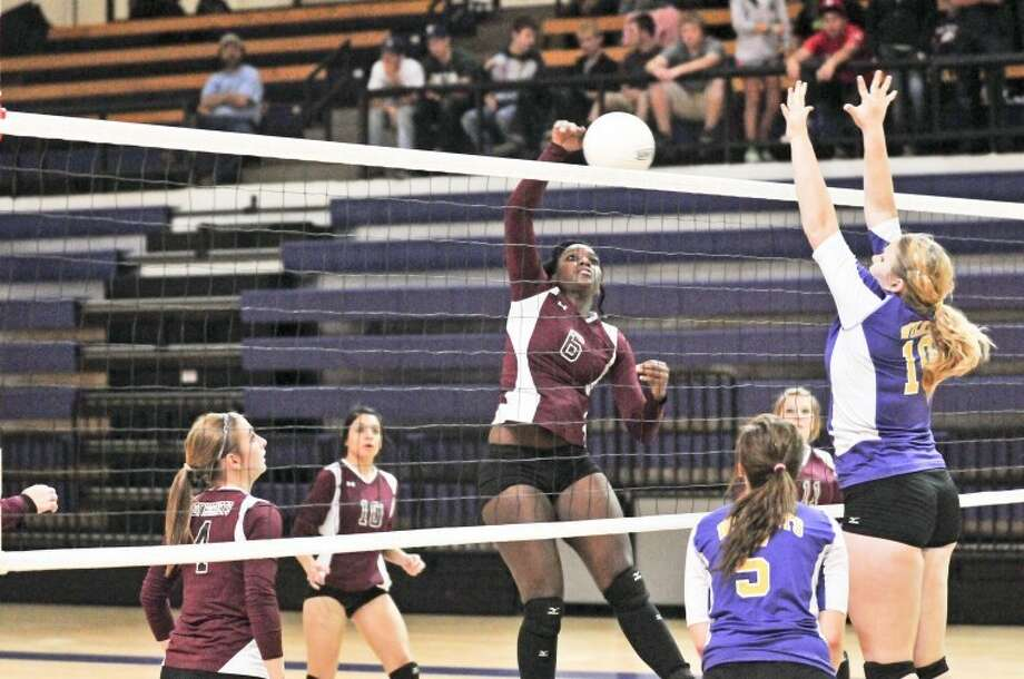 The Tulia Lady Hornets' Tierra Richardson (No. 6) goes up for an attack as River Road's Erica Gammage (10) defends during a Class 2A bi-district playoff match at Canyon High School on Tuesday. Photo: Kevin Lewis/Plainview Herald