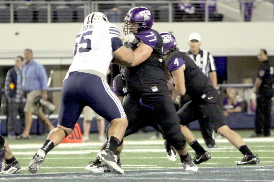 TCU senior offensive lineman Spencer Thompson (77) of Plainview blocks BYU's Eathyn Manumaleuna during last Friday's game at Cowboys Stadium in Arlington. TCU won 38-28. Thompson played both tackle and both guard positions in the game.