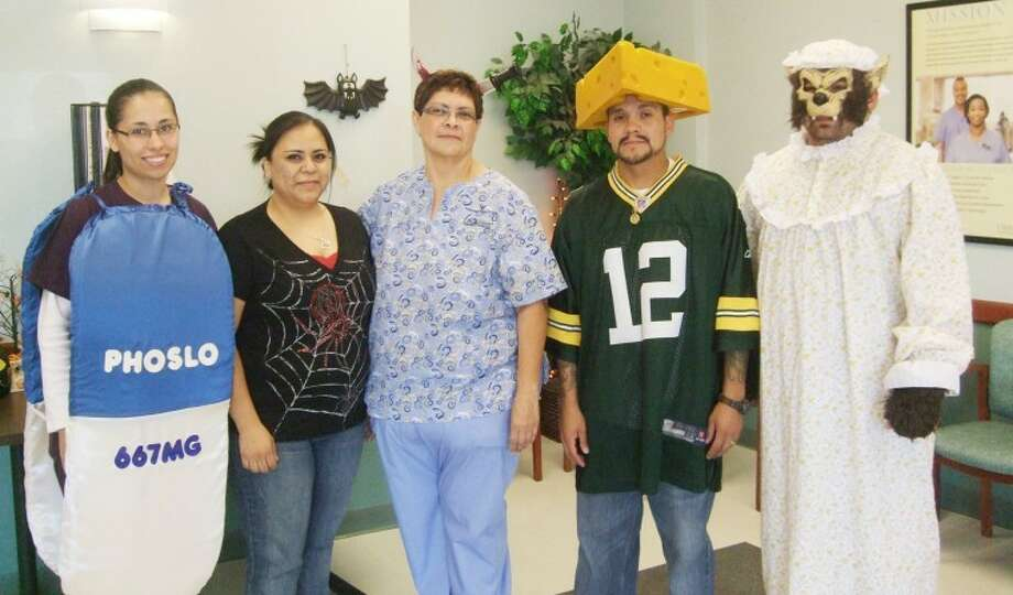 Staff at Plainview Dialysis Center — Cynthia Subealdea (left), dietitian; Veronica Garcia, LVN; Belinda Sanchez, PCT; Primo Salazar, PCT; and Bruno Sandoval, clinic manager — were among those who got in the spirit of Halloween on Monday. (Send your Halloween photos to jthornton@hearstnp.com to be posted at MyPlainview.com.) Photo: Jessica Thornton/Plainview Herald
