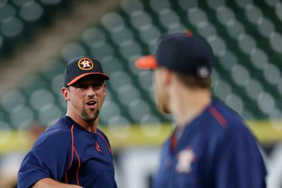 Houston Astros pitcher Luke Gregerson loudly announces the arrival of Alex Bregman during batting practice before the start of an MLB game at Minute Maid Park, Monday, July 25, 2016, in Houston.