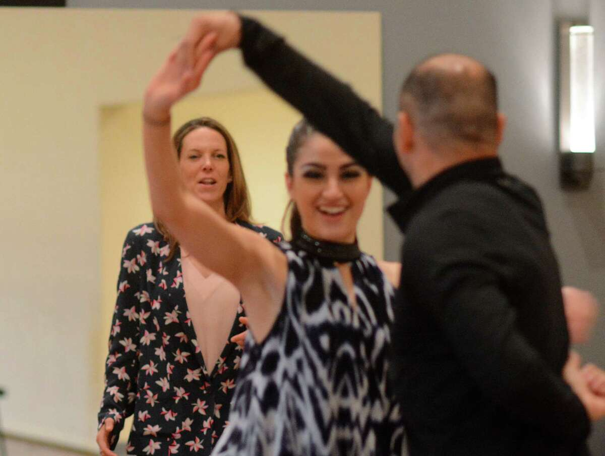 Stephanie Schlueter, owner of the Fred Astaire Dance Studio, watches dance instructors Skylor Sansing and Joel Diaz, both of The Woodlands, during a training session at the dance studio. Photograph by David Hopper