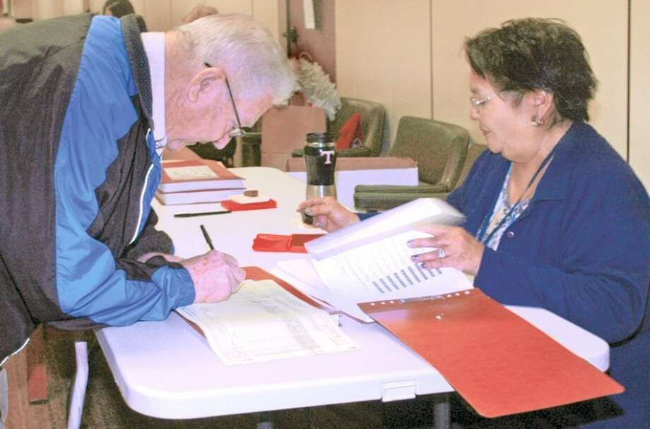 Gordon Zeigler/Plainview HeraldElection worker Lupe Castillo helps early voter Robert Saltzman prepare to cast a ballot Wednesday concerning 10 proposed Texas constitutional amendments. Through Wednesday evening, a total of 129 early ballots had been cast in Plainview, 17 in Hale Center, 19 in Abernathy and 22 in Petersburg. Early voting continues through 5 p.m. Friday in the basement of the Hale County Courthouse and on Friday from 8 a.m.-noon and 1-5 p.m. at Abernathy and Petersburg city halls and from 8 a.m.-noon at Hale Center City Hall. Election day voting will be 7 a.m.-7 p.m. Tuesday at the Ollie Liner Center, Hale Center Fire Department, Abernathy City Hall Courtroom and Petersburg Community Center.