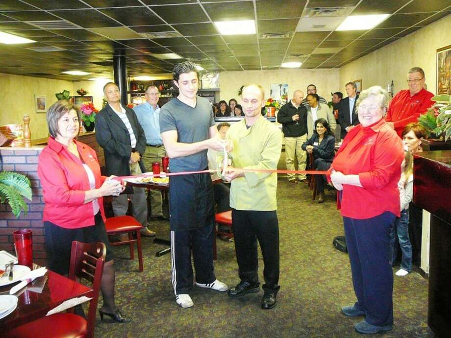 The Plainview Chamber of Commerce hosted a ribbon cutting Wednesday at Napoli's Italian Restaurant, located at 1011 N. I-27 Suite 238 in Stonegate Plaza. Here, Chamber Redcoats Lydia Castillo (left) and Janice Payne hold the ribbon while chef Alban Sichi (left) and owner Afrin Mahmetij cut it. Those attending the event were treated to a buffet of the restaurant's many fresh dishes - including pasta, pizza, sandwiches, steaks, chicken and seafood - and desserts.