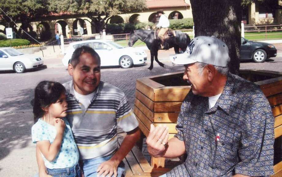 Israel Hernandez and his daughter visit with Abraham Almaraz in Fort Worth. Photo: Gail M. Williams | Plainview Herald