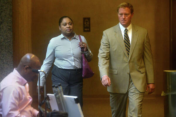 Naomi Lawrence-Lee arrives with attorney Todd Ward as her trial gets underway with jury selection in Judge John Stevens' Criminal District Court Monday. Lawrence-Lee, a former Assistant Director of Finance/Purchasing for BISD, is indicted on embezzlement charges alleging she falsified invoices to steal roughly $17,000 from the district. She is pleading not guilty to the charges. Photo taken Monday, July 25, 2016 Kim Brent/The Enterprise