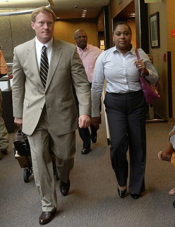 Naomi Lawrence-Lee makes her way into the courtroom with attorney Todd Ward as her trial gets underway with jury selection in Judge John Stevens' Criminal District Court Monday. Lawrence-Lee, a former Assistant Director of Finance/Purchasing for BISD, is indicted on embezzlement charges alleging she falsified invoices to steal roughly $17,000 from the district. She is pleading not guilty to the charges. Photo taken Monday, July 25, 2016 Kim Brent/The Enterprise Photo: Kim Brent / Beaumont Enterprise