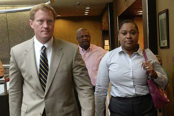 Naomi Lawrence-Lee makes her way into the courtroom with attorney Todd Ward as her trial gets underway with jury selection in Judge John Stevens' Criminal District Court Monday. Lawrence-Lee, a former Assistant Director of Finance/Purchasing for BISD, is indicted on embezzlement charges alleging she falsified invoices to steal roughly $17,000 from the district. She is pleading not guilty to the charges. Photo taken Monday, July 25, 2016 Kim Brent/The Enterprise