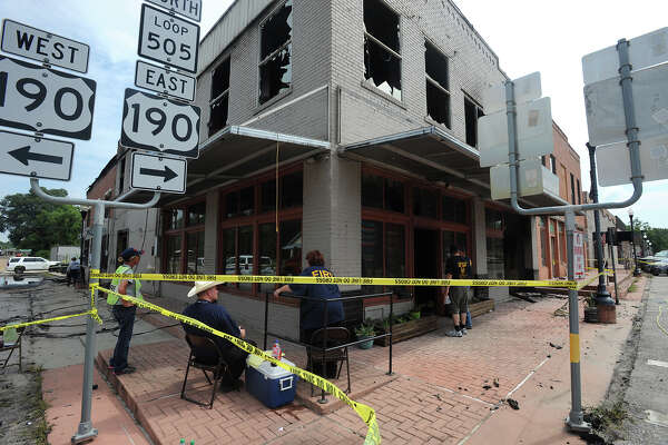 A fire in downtown Newton destroyed the Courthouse Square Saturday night. The blaze burned four companies and one residence. No major injuries were reported and State fire marshals are conducting an investigation to the cause of the blaze.      Saturday evening to noon Sunday.  Photo taken Monday, July 25, 2016 Guiseppe Barranco/The Enterprise