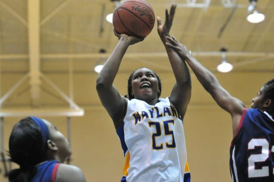 Wayland Baptist junior Maty Diallo (25) goes up for a shot as University of the Southwest forward Lateasha Shelton (right) defends during the Queen's home opener Saturday at Hutcherson Center. Photo: Ryan Thurman/Plainview Herald