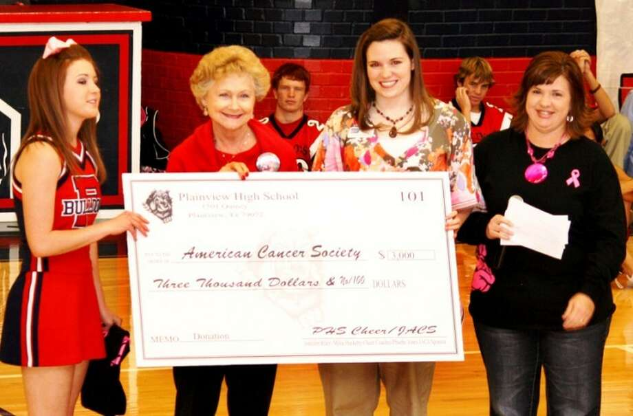 Jan Seago/Plainview ISDPHS cheerleader and Junior American Cancer Society President Channing Snipes (left) and Junior ACS sponsor Phoebe Jones (right) present a $3,000 check to Alice Sawayer (second from left), Hale County ACS board president, and Emily Balke, Panhandle regional community manager for ACS, during a recent PHS pep rally. Photo: Jan Seago/Plainview ISD