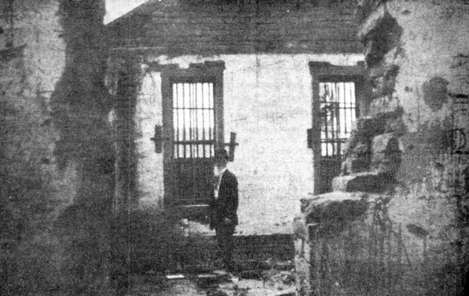 J.M. Shafer, editor and publisher of the early-day Hale County Herald, is shown in the old sod jailhouse that preceded the Hale County Jail built in 1908 and located at Fifth and Ash. Photo: Herald File Phot