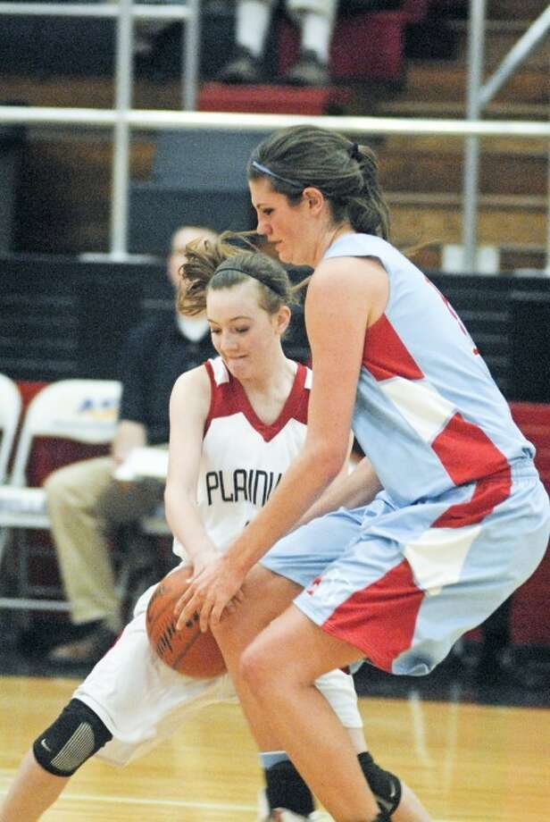 Plainview Lady Bulldog 5-foot-5 freshman Meredith McDonough (left) battles with Monterey's 6-5 senior Kellyn Schneider during Friday's game at the DogHouse. Photo: Kevin Lewis/Plainview Herald
