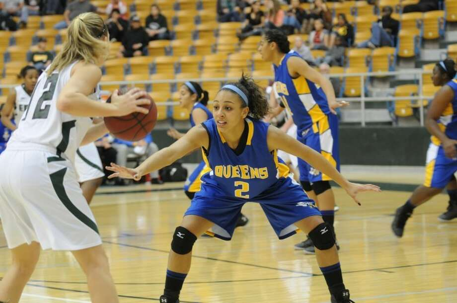 Wayland's Angeleigh Davis (2), a junior guard from Buda, defends in a game against Eastern New Mexico. Davis is the Queens' leading scorer and rebounder. Photo: Wayland Baptist University Photo