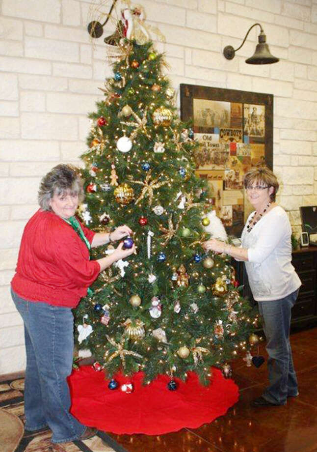 daleyn schwartz left and tammy fields decorate a tree of hope schwartz is