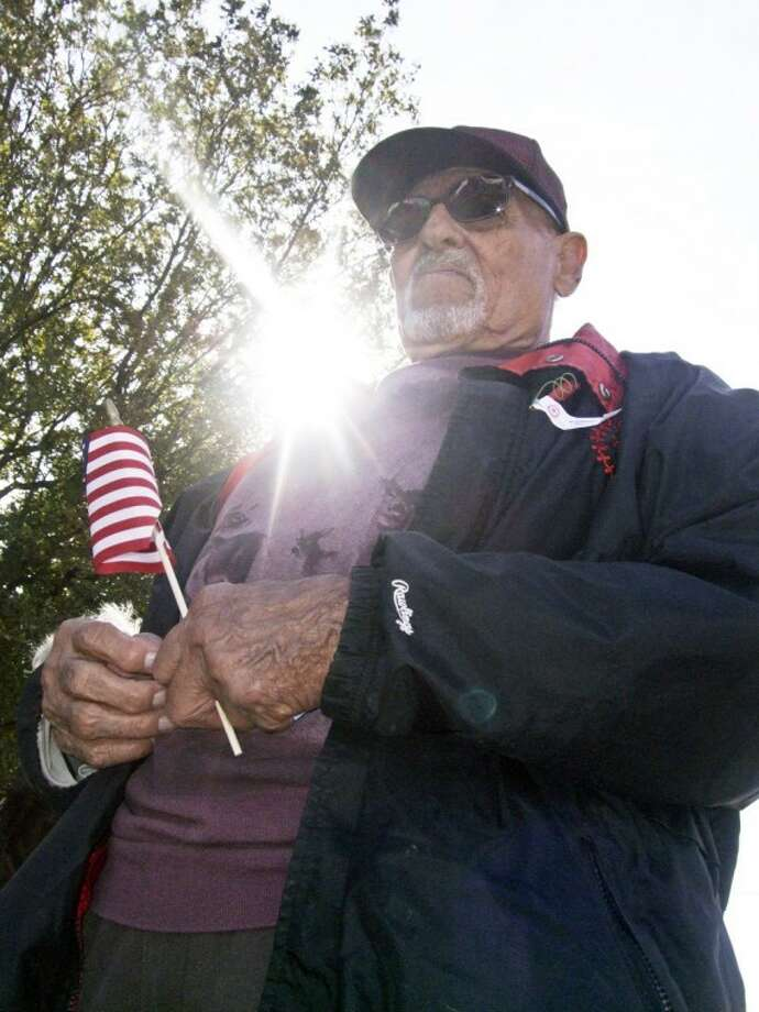 Victor Rodriguez reflects during the benediction at the citywide Veteran's Day observance on Friday at the Veterans Memorial outside the Hale County Courthouse. Rodriguez, 82, and his son, Victor Rodriguez Jr., who also attended the ceremony, are veterans of the U.S. Army. Photo: Kevin Lewis/Plainview Herald