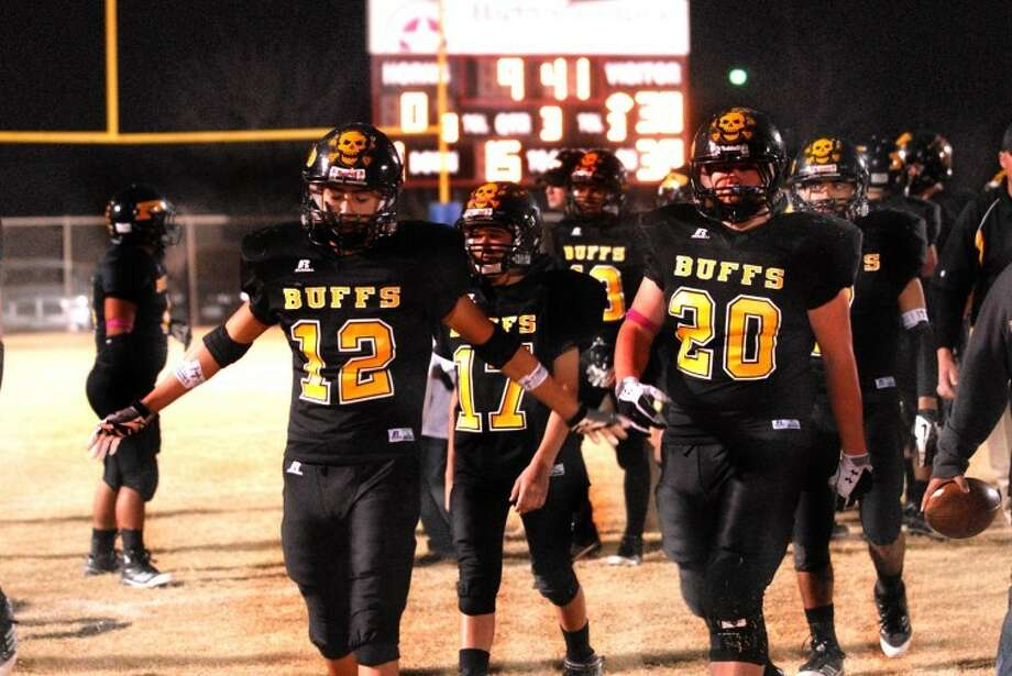 The Petersburg Buffaloes march off the field in Lockney after their playoff run came to an end after a loss to district rivals Valley. Photo: Homer Marquez/Plainview Herald