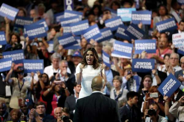 Actress Eva Longoria introduces Sen. Cory Booker, D-NJ., during the first day of the Democratic National Convention in Philadelphia , Monday, July 25, 2016. (AP Photo/Matt Rourke)