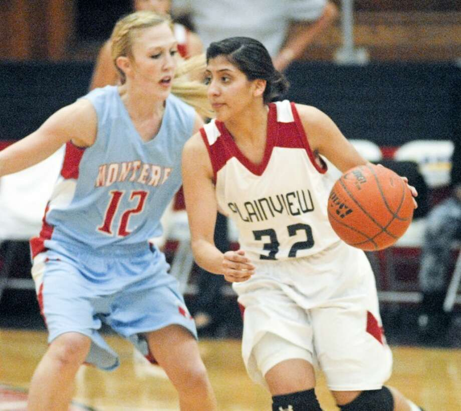 Plainview Lady Bulldog senior point guard Laura Castillo (32) dribbles at the top of the key as Monterey's Layla Salmeh (12) defends during last Friday night's game at the DogHouse. Photo: Kevin Lewis/Plainview Herald
