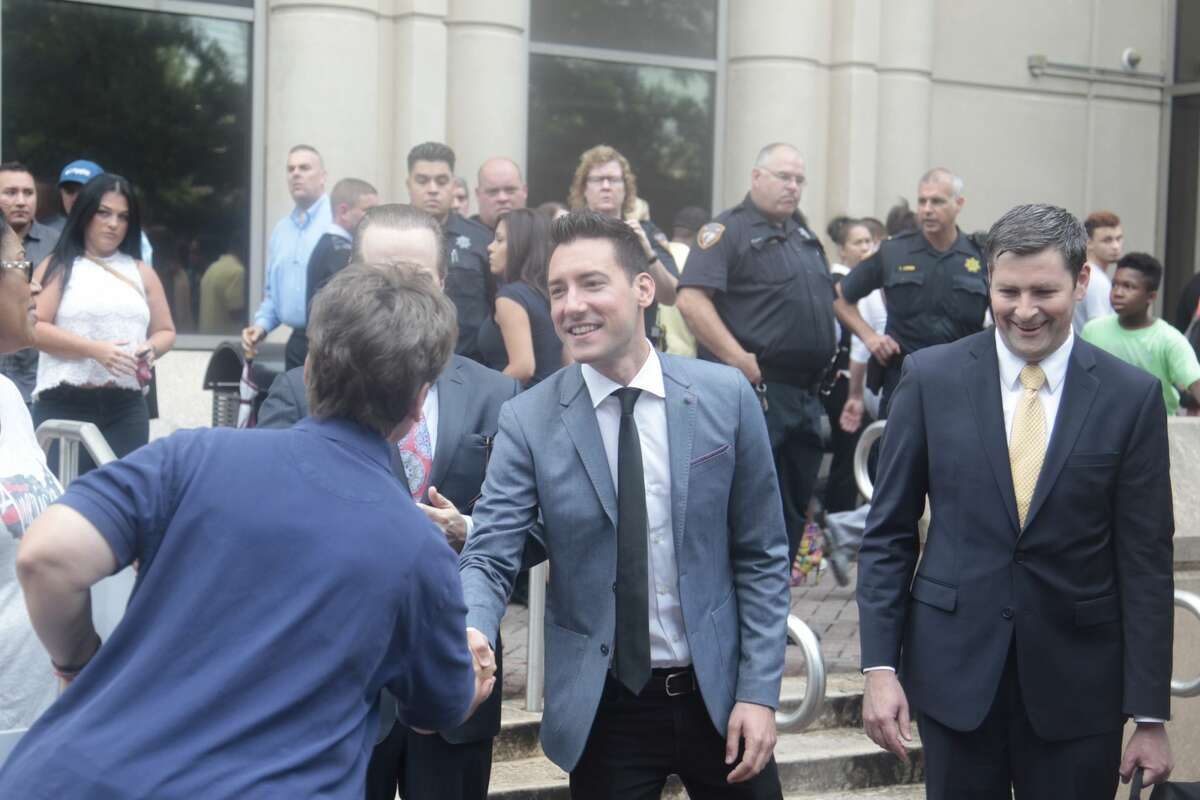 David Robert Daleiden is thanked by supports after the Harris County District Attorney's office on Tuesday dismissed all charges against anti-abortion activists who secretly videotaped Planned Parenthood officials in Houston.