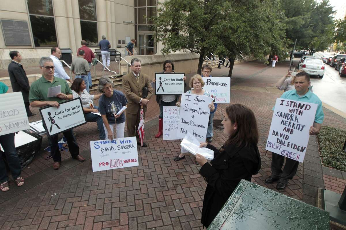 The Houston Coalition for Life supporters gather outside the Harris County Criminal Justice Center on Tuesday, June 26, 2016. The district attorney's office dismissed all charges against anti-abortion activists who secretly videotaped Planned Parenthood officials in Houston.