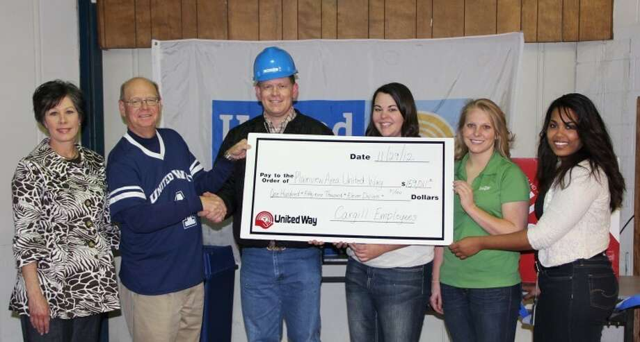 A donation from Cargill Meat Solutions and its employees of $159,011.31 put this year's Plainview Area United Way campaign over the top of its $435,000 goal. Taking part in Thursday's victory rally at Cargill are Nancy Stukey (left), United Way Division II chair; Mike Fox, United Way campaign chair; Jarrod Gillig, Cargill plant general manager; and plant United Way representatives Elizabeth Coughlin, Charli Rice and Rhnae Robinson. Photo: Doug McDonough/Plainview Herald