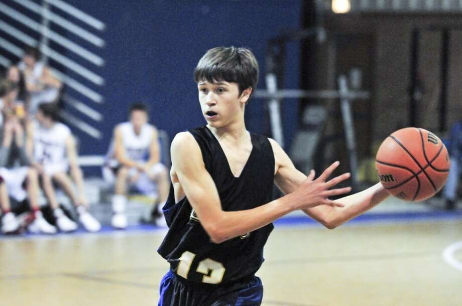 Plainview Christian JV player Kenneth Landtroop looks to make a pass.