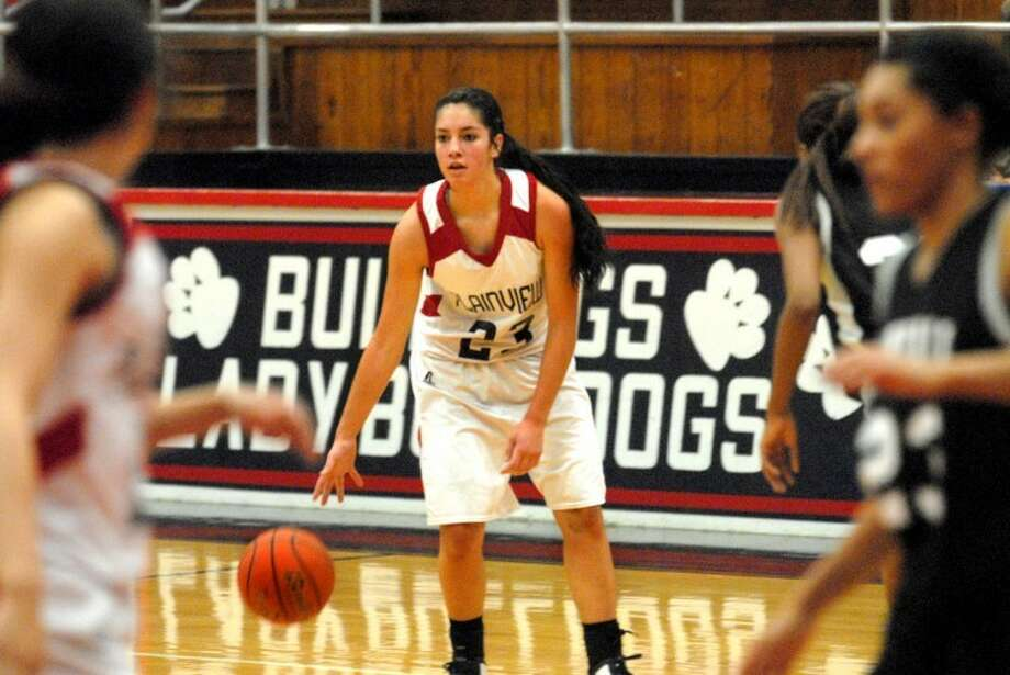 Lady Dogs Karli Wheeler looks for an opening in a recent Plainview game with the Randall Lady Raiders. Photo: Homer Marquez/Plainview Herald