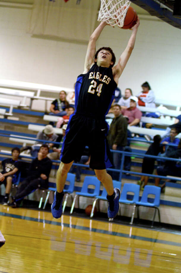 Eagle Kenneth Landtroop goes for the dunk at a recent game. Photo: Cathy Landtroop For Plainview Herald