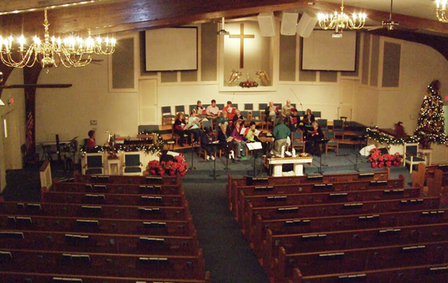 Community Choir members rehearse late Wednesday evening with choir director Joe Berry of College Heights Baptist Church. Photo: Gail M. Williams | Plainview Herald