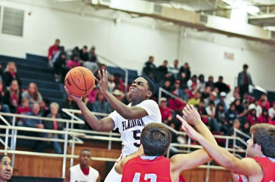 The Plainview Bulldogs' Quaveien Thomas (5) goes up for a layup during a non-district game Friday against the Monterey Plainsmen in the DogHouse. Monterey held on to win 65-56. Thomas led all scorers with 20 points. Photo: Ryan Thurman/Plainview Herald